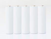 Batteries d'aa au-dessus de blanc Photos stock