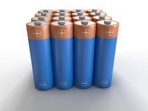 Batteries d'aa dans les rangées photos stock