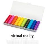 Batteries de différentes couleurs dans une boîte Images stock