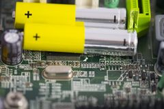 Batteries and integrated circuits Royalty Free Stock Photos