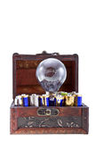 Batteries energy for an idea 2. Batteries energy for an idea concept shot. Opened treasure chest with batteries and and a bulb lamp inside isolated on white royalty free stock image