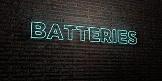 BATTERIES - enseigne au néon réaliste sur le fond de mur de briques - image courante gratuite de redevance rendue par 3D Photographie stock