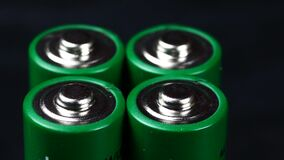 Batteries in extreme close up UHD stock footage. A collection of AA batteries in true macro close up with a sliding