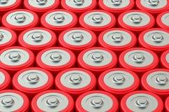 Batteries. Macro view of orange type AA batteries Stock Photos