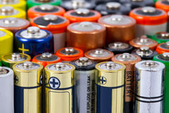 Batteries. Many AA sized batteries on white Royalty Free Stock Images