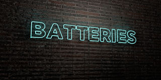 BATTERIES -Realistic Neon Sign on Brick Wall background - 3D rendered royalty free stock image Stock Photography