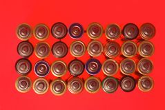 Batteries seen from above on red Stock Image