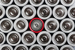 Batteries set with contrast red one in the middle Royalty Free Stock Photo