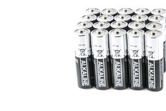 Batteries. Silver and black batteries aligned and isolated on a white background Royalty Free Stock Photography