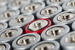 Batteries tops macro with contrast red one. Batteries tops macro shot with contrast red one in the middle Royalty Free Stock Photography