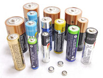 Batteries. Variety of used batteries isolated on white background