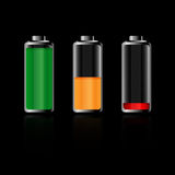 Batteries - vector. Illustration of three batteries isolated on black background: charge full, low and empty.EPS file available Stock Photo