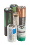 Batteries on white. Different size batteries isolated on white Royalty Free Stock Photo
