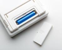 Batterij in de contactdoos Stock Fotografie