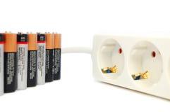 Batterijen en het koord van de machtsuitbreiding Stock Afbeelding