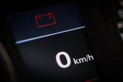 Batterijsymbool in een auto Stock Foto's