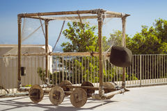 Battering RAM on wheels in the fortress of Santa Barbara. ALICANTE, SPAIN - SEPTEMBER 9, 2014: Battering RAM on wheels on the protective wall in the fortress of Stock Photography