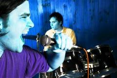 Batterista e cantante di roccia Fotografie Stock
