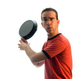Batters Up. Humorous man pretending to swing a cast-iron pan like a baseball player Stock Photo