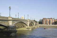 Battersea Bridge, London. View from the Wandsworth side of the Thames of Battersea Bridge which links across the river to Chelsea, London Stock Image
