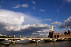 Battersea Bridge and Powerstation. Abandoned powerstation in London, an iconic building of London skyline, featured on Pink Floyd's album cover Animals Royalty Free Stock Photography