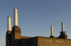 Battersea Power Station Chimneys. The four chimneys of the old Battersea Power Station in London lit by late afternoon sun Royalty Free Stock Photography