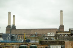 Battersea Power Station over rooftops. View across abandoned factories towards the disused Battersea Power Station in Wandsworth, London Stock Photography