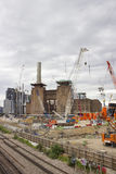 Battersea power station redevelopment. London, England - May 22, 2016: Construction cranes over the Battersea power station currently being rebuilt, and Stock Photo