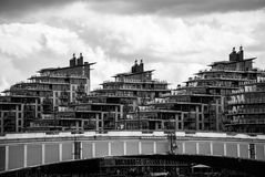 Battersea Reach. LONDON, UK - MAY 25, 2014: Battersea Reach estate behind Wandsworth Bridge in London. Processed in black and white Royalty Free Stock Photos