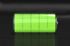 Battery. At full charge on dark background Royalty Free Stock Images