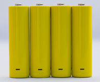 Battery. Yellow small battery with positive and negative signs Stock Image