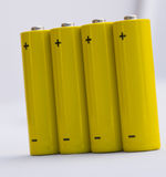 Battery. Yellow small battery with positive and negative signs Royalty Free Stock Photography