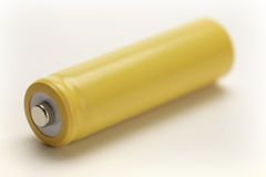 Battery. One yellow rechargeable battery on white background Stock Images