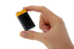 Battery - 9v (PP3) in fingers Royalty Free Stock Photo