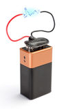 The battery is a accumulator with a blue lightning discharge. Royalty Free Stock Photo