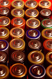 Battery,batteries lined with red background Royalty Free Stock Image