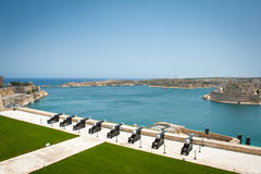 Battery of Cannons facing Harbor in Malta. Upper Barrakka Gardens Stock Image