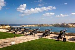 Battery of Cannons facing Harbor in Upper Barrakka Gardens. In Valletta, Malta Royalty Free Stock Images