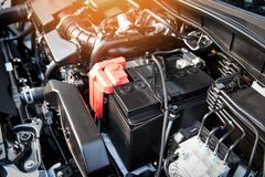 Battery car engine detail motor - close up of machine new batteries car engine checking car battery cleaning for deliver customers