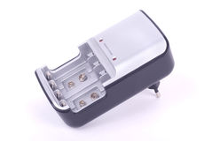 Battery charger. Gray battery charger on white Stock Images