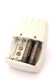 Battery Charger. Universal AA and AAA battery charger with two batteries Royalty Free Stock Images