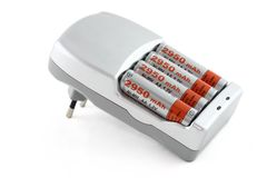 Battery charger. A battery charger isolated (with clipping path Royalty Free Stock Photos
