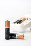 Battery charger and batteries on a white background Stock Photography