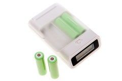 Battery charger with four AA batteries. Stock Images