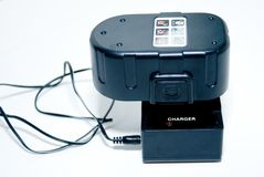 Battery Charger for Tools. A battery pack, for tools, on the charger Stock Images