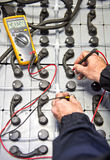 Battery check with multimeter royalty free stock images