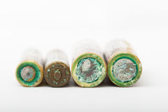 Battery corrosion. Corrosion at ends on dry cell batteries Stock Image