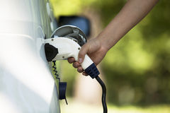 Battery electric vehicle. Charging battery of an electric car Stock Photos