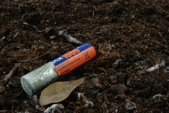 Battery. Environmental pollution. The old battarey decomposes in the ground Stock Images