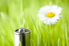 Battery on a fresh grass Stock Photography